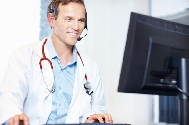 happy_physician_reading_online (1)